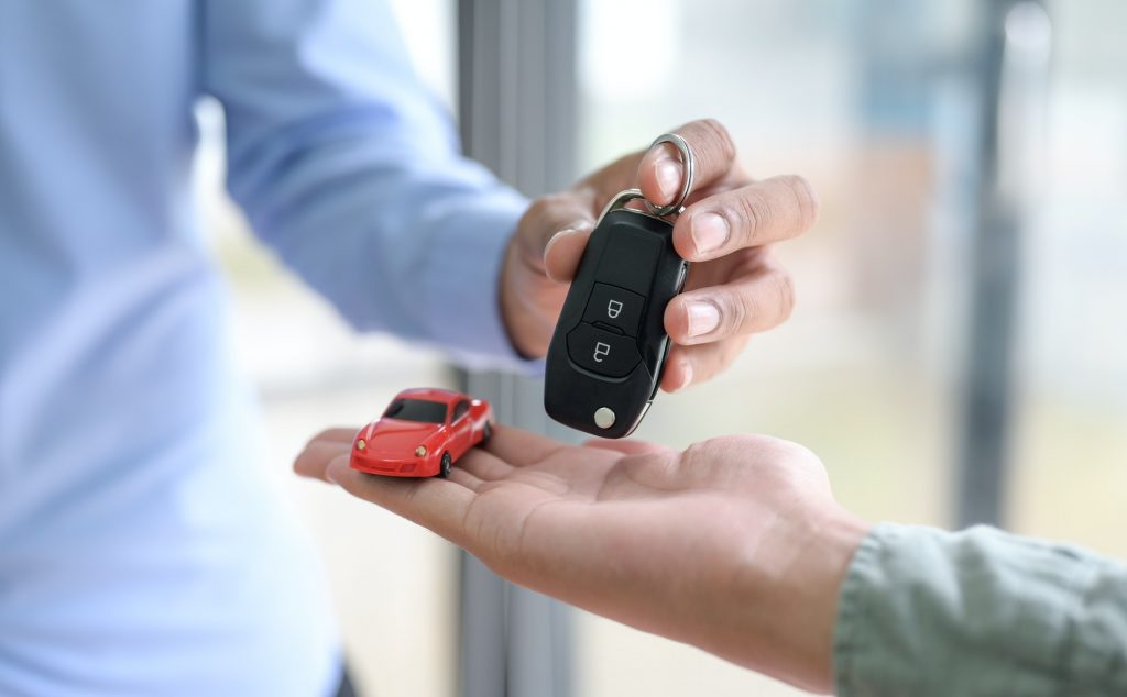 Close-up shot of Sellers handing over car keys to customers,Car sales ideas.